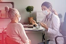 Stockfoto Arztbesuch - Patientin und Ärztin